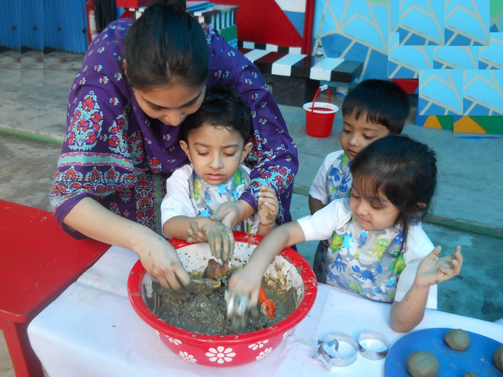 Mud Work By Playgroup Students
